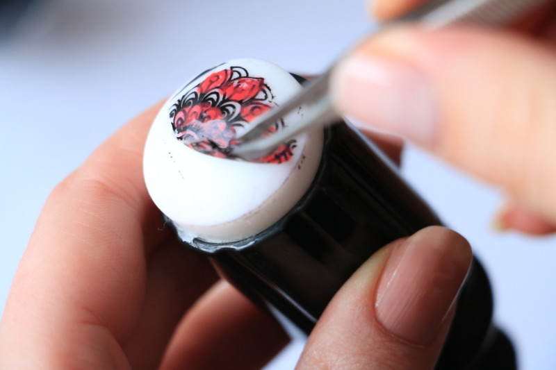 9. Take off the dried design with tweezers.
